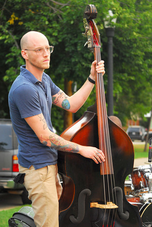 Evan Harrison Parker plays his bass guitar with the David Mayfield Parade as the band plays a show Sunday at Lions Park during the Summer Breeze Concert Series.<br /> Kyle Phillips/The Transcript