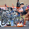 Two competitors in the Tie Dye Tri get their bicycles ready as they prepare for a 12 mile bike ride and a 5K run after completing a 500 yard swim at the YMCA Sunday morning.  To see more photos from the event visit photos.normantranscript.com.<br /> Kyle Phillips/The Transcript