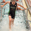 Dylan Mitchell rushes out of the pool during the  Tie Dye Tri after the 500 yard Snake Swim in the pool at the YMCA.  After the swim, athletes were to complete a 12 mile bike ride and a 5K run.  To see more photos from the event visit photos.normantranscript.com.<br /> Kyle Phillips/The Transcript
