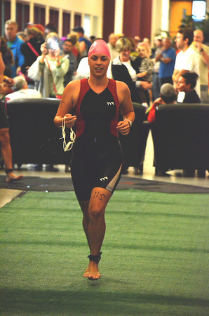 Charlene Bockus runs through the halls of the YMCA as she heads to the bike portion of the Tie Dye Tri Sunday morning.  To see more photos from the event visit photo.normantranscript.com.<br /> Kyle Phillips/The Transcipt