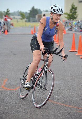 Katie Kimberling rounds the first corner of a 12 mile bike ride Sunday during the Tie Dye Tri at the YMCA.  Competitors also swam a 500 yard Snake Swim and ran a 5k during the event.  To see more picture from the triathalon visit photos.normantranscript.com.<br /> Kyle Phillips/The Transcript