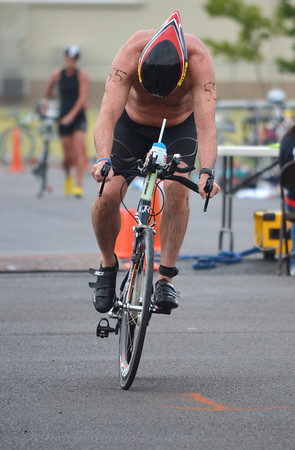 Bart Boren  starts the bike portion of the Tie Dye Tri Sunday morning, which will take him on a 12 mile ride followed by a 5k run.  To see more photos from the event visit photos.normantranscript.com