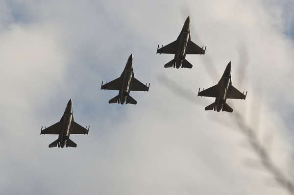 Air Force jets fly over Reaves Park Sunday during Norman's Veterans Day ceremony at Reaves Park.<br /> Kyle Phillips/The Transcript