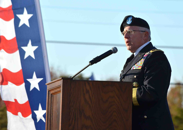 Army National Guard Maj. Gen. Myles Deering speaks to a crowd Sunday   during the Veterans ceremony  at Reaves Park.<br /> Kyle Phillips/The Transcript