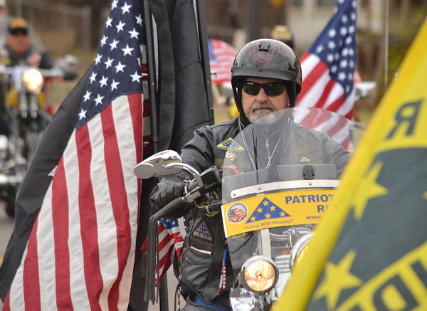 A menber of the Patriot Guard Riders participates in Norman's Veterans Day parade Sunday afternoon.<br /> Kyle Phillips/The Transcript