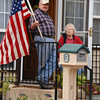 Don and Suzy Canon watch the Veterans Day Parade  from their front porch as it goes down Jenkins Ave. Sunday afternoon.<br /> Kyle Phillips/The Transcript