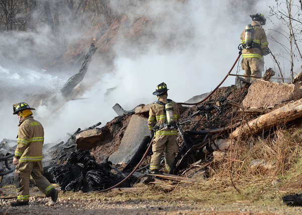 Norman firefighters spray down rubber filters at the waste water treatment plant Wednesday afternoon after sparks from a torch caught the area on fire.    No one was injured in the blaze.<br /> Kyle Phillips/The Transcript