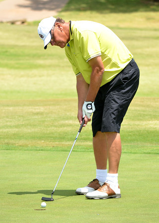 Bill Allen putts the ball on the 17th green during the Westwood Invitational Sunday afternoon.<br /> Kyle Phillips/The Transcript