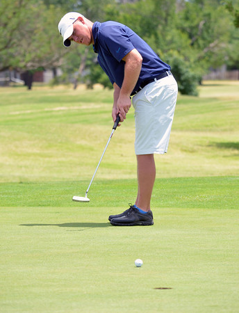 Travis Smith putts his ball into the hole on the 6th green during the Westwood Invitational Sunday afternoon.  To see more photos from the tournament visit photos.normantranscript.com.<br /> Kyle Phillips/The Transcript