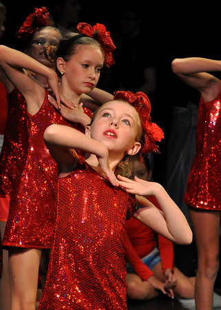 Maddie McKown as a poppy flower rehearses her dance for the Wizard of Oz. Julie Bragg/ The Transcript