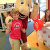 Josh Langley poses for a picture with OU mascot  Boomer Satuday afternoon at  a tailgate event at Shoe Carnival in Moore.  The event included autographs from OU Cheerleaders, a raffle and a chance to meet the Sooner mascot.<br /> Kyle Phillips/The Transcript