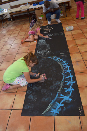 Kids draw their art for the Sidewalk Chalk Art Contest at the Performing Arts Studio at the Santa Fe Depot Saturday morning.  The contest is part of the CROP Walk event, which will be held on Oct. 7 and will begin and end at Norman's Food & Shelter Inc.<br /> Kyle Phillips/The Transcript