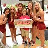 Josh Langley poses for a picture with members of the OU Cheerleading squad Satuday afternoon at  a tailgate event at Shoe Carnival in Moore.  The event included autographs from OU Cheerleaders, a raffle and a chance to meet the Sooner mascot.<br /> Kyle Phillips/The Transcript