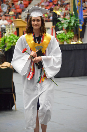 A Westmoore graduate walks back to her seat after receiving her diploma Saturday afternoon during the Jaguars' graduation ceremony at the Cox Convention Center in Oklahoma City.<br /> Kyle Phillips/The Transcript