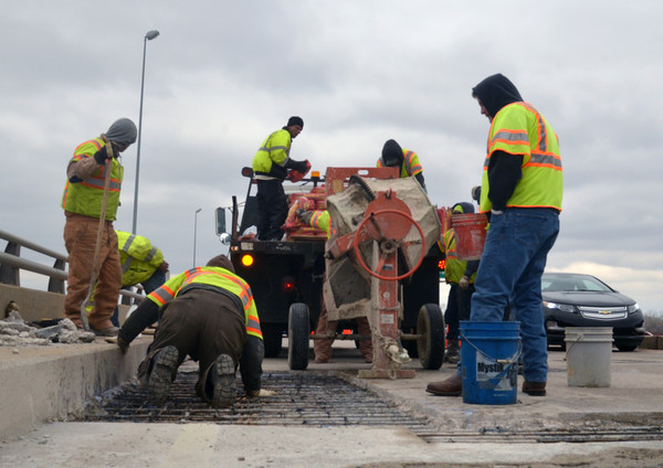Workers from Silver Star construction do an emergency repair on the Lindsay Street bridge over Interstate 35 Sunday, Mar. 10, 2012.<br /> Kyle Phillips/The Transcript