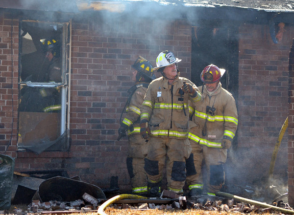 Norman Firefighter investigate a fire at 2308 Memphis Dr. Tuesday afternoon.  The garage was fully engulfed when fire crews arrived and had spread to the house behind.  No one was injured in the blaze, but the garage is a total loss.  The cause is under investigation.<br /> Kyle Phillips/The Transcript