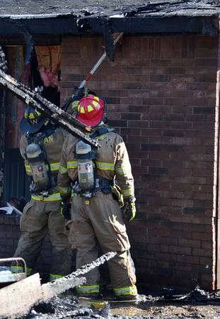 Norman Firefighters work a fire at 2308 Memphis Dr. Tuesday afternoon.  The garage was fully engulfed when fire crews arrived and had spread to the house behind.  No one was injured in the blaze, but the garage is a total loss.  The cause is under investigation.<br /> Kyle Phillips/The Transcript