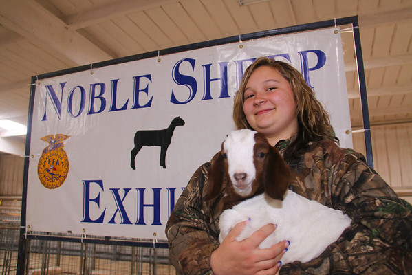 "Two week-old boer goat ""Princess"" is being raised by Nita Foutch, a 15 year old freshman at Noble High School at the Cleveland County Fairgrounds Tuesday, Feb. 26.  Foutch said she enjoys helping her sister and told of their plans for the 15 pound goat.  ""We're gonna bottle feed it and train it up, then we'll show it next year!""  Jay Chilton/The Transcript"