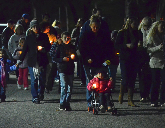 Members of the community gather Monday evening for a candle light vigil held in response to the school shooting in Conneticut last week.<br /> Kyle Phillips/The Transcript