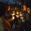 Members of the community come together to light their candles before a Monday evening during a candle light vigil held in response to the school shooting in Conneticut last week.<br /> Kyle Phillips/The Transcript