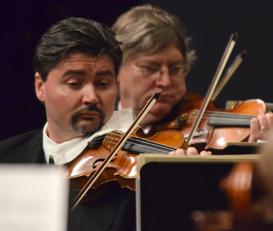 """Concertmaster Michael Sutton, left, plays the violin Sunday during the  Norman Philharmonics """"Meet the Composer"""" concert at the Nancy O'Brian Center for Performing Arts.<br /> Kyle Phillips/The Transcript"""