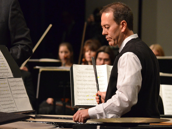 Soloist Dr. Lance Drege plays the timpani  as the group performs during a concert Sunday at the Nancy O'Brian Center for the Performing Arts.<br /> Kyle Phillips/The Transcript