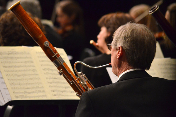 A member of the Norman Philharmonics plays his instrument as the group performs during a concert Sunday at the Nancy O'Brian Center for the Performing Arts.<br /> Kyle Phillips/The Transcript