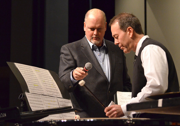 """Composer Michael Daugherty talks with soloist Dr. Lance Drege on stage about playing  the timpani as the group """"Meet the Composer"""" concert  Sunday at the Nancy O'Brian Center for the Performing Arts.<br /> Kyle Phillips/The Transcript"""