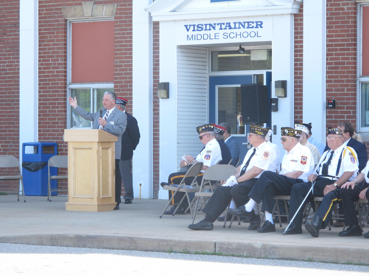 ELIZABETH DOBBINS/GAZETTE State Rep. Steve Hambley, R-Brunswick, speaks during a Memorial Day ceremony Monday at Visintainer Middle School in Brunswick.