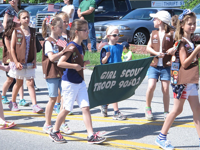 ELIZABETH DOBBINS / GAZETTE Girl Scout Troop 90502 march during the Brunswick Memorial Day Parade.
