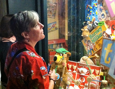 BOB SANDRICK / GAZETTE  Michele Connor of Baltimore gazed at a display of classic toys at Castle Noel on Saturday during its Christmas in July festival.