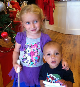 BOB SANDRICK / GAZETTE  Halle Piero, 3, and her cousin Sawyer Blankenship, 1, visited Castle Noel on Saturday for the entertainment center's Christmas in July festival.