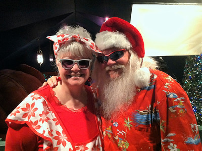 BOB SANDRICK / GAZETTE  Santa and Mrs. Claus greeted visitors Saturday at Castle Noel's Christmas in July festival.