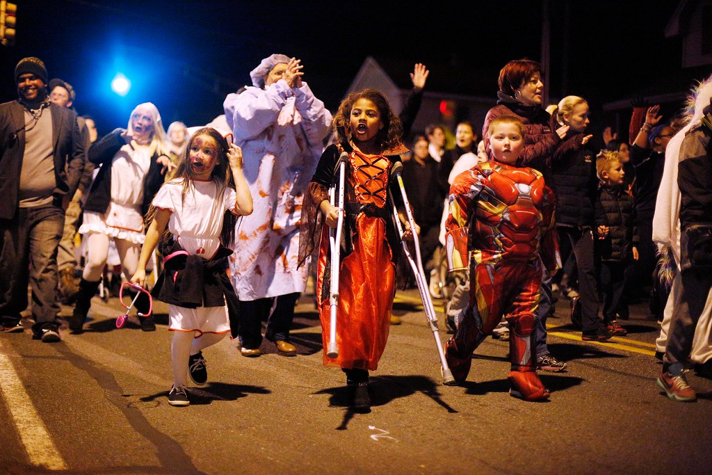 . Conte Community School students and teachers walk behing their \'Haunted Hospital\' float during the annual Halloween Parade on Tyler Street in Pittsfield. Friday, October 28, 2016. Stephanie Zollshan � The Berkshire Eagle | photos.berkshireeagle.com