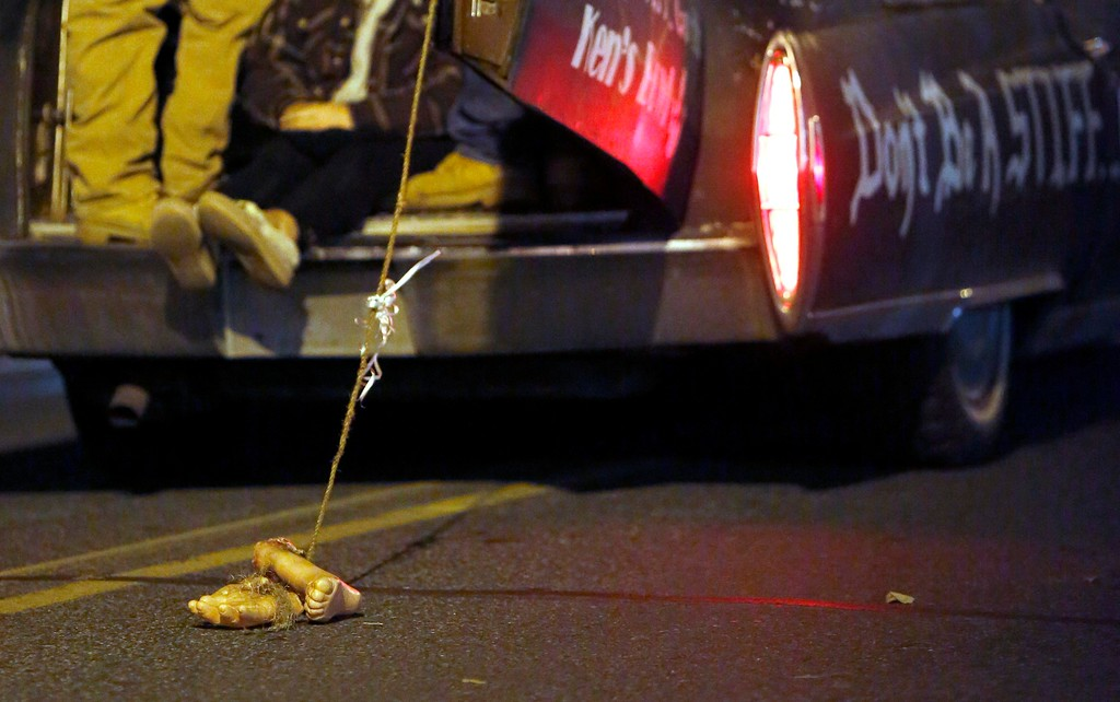 . A hearse from Ken\'s bowl drags severed feet behind it during the annual Halloween Parade on Tyler Street in Pittsfield. Friday, October 28, 2016. Stephanie Zollshan � The Berkshire Eagle | photos.berkshireeagle.com