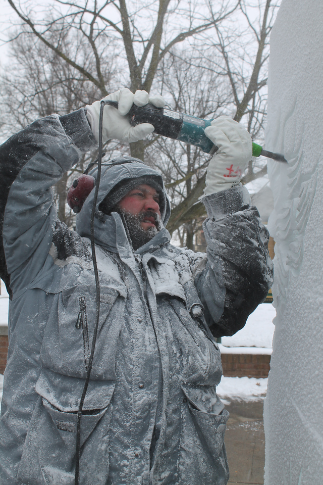 "LAWRENCE PANTAGES / GAZETTE Jeff Meyers of Elegant Ice Creations works Friday afternoon getting a ""Fire and Ice"" display ready for the opening ceremonies of the 22nd Medina Ice Festival. Meyers, of Brunswick, said he has been a carver for 14 years."