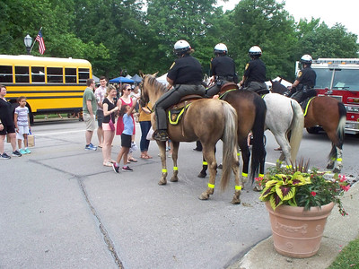NIKKI RHOADES / GAZETTE Families and children enjoyed the opportunity to see mounted police horses up close during a program called Kids Day held Saturday on Public Square in Medina.