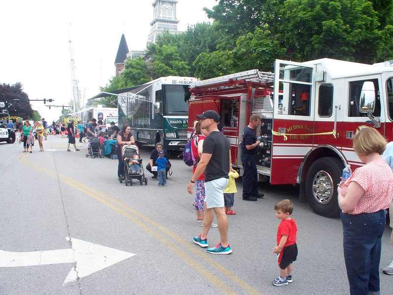 NIKKI RHOADES / GAZETTE Families and children learned about medical topics from a Cleveland Clinic Akron General mobile unit and fire safety during a program called Kids Day held Saturday on Public Square in Medina.