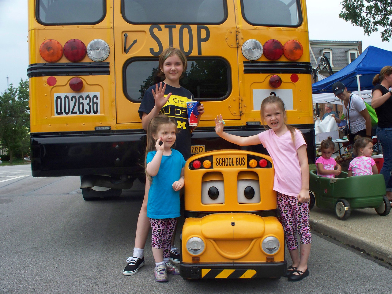 "NIKKI RHOADES / GAZETTE From left, sisters Serenity Courtwright, 11, Beatrice Thompson, 4, and Jacquelyne Thompson, 5, learned about school bus safety with Medina City Schools this weekend at Kids Day of Safety & Play. They were at the event with their grandmother Deborah Thompson, who said, ""It's a pretty fantastic event. We have had a lot of fun."""