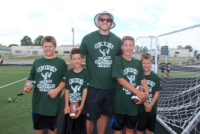 HALEE HEIRONIMUS / GAZETTE Pictured from left: Karik Wickam, 12, Landon Gillis, 8, Kyle Juszczyk, Braelen Gillis, 11, and Bryden Wickam, 9, drove up from Columbus to attend Juice's Future All-Stars camp Saturday morning.