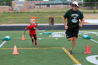 HALEE HEIRONIMUS / GAZETTE Tommy Hohn, 8, races Kyle Juszczyk during the speed and foot skills drill.