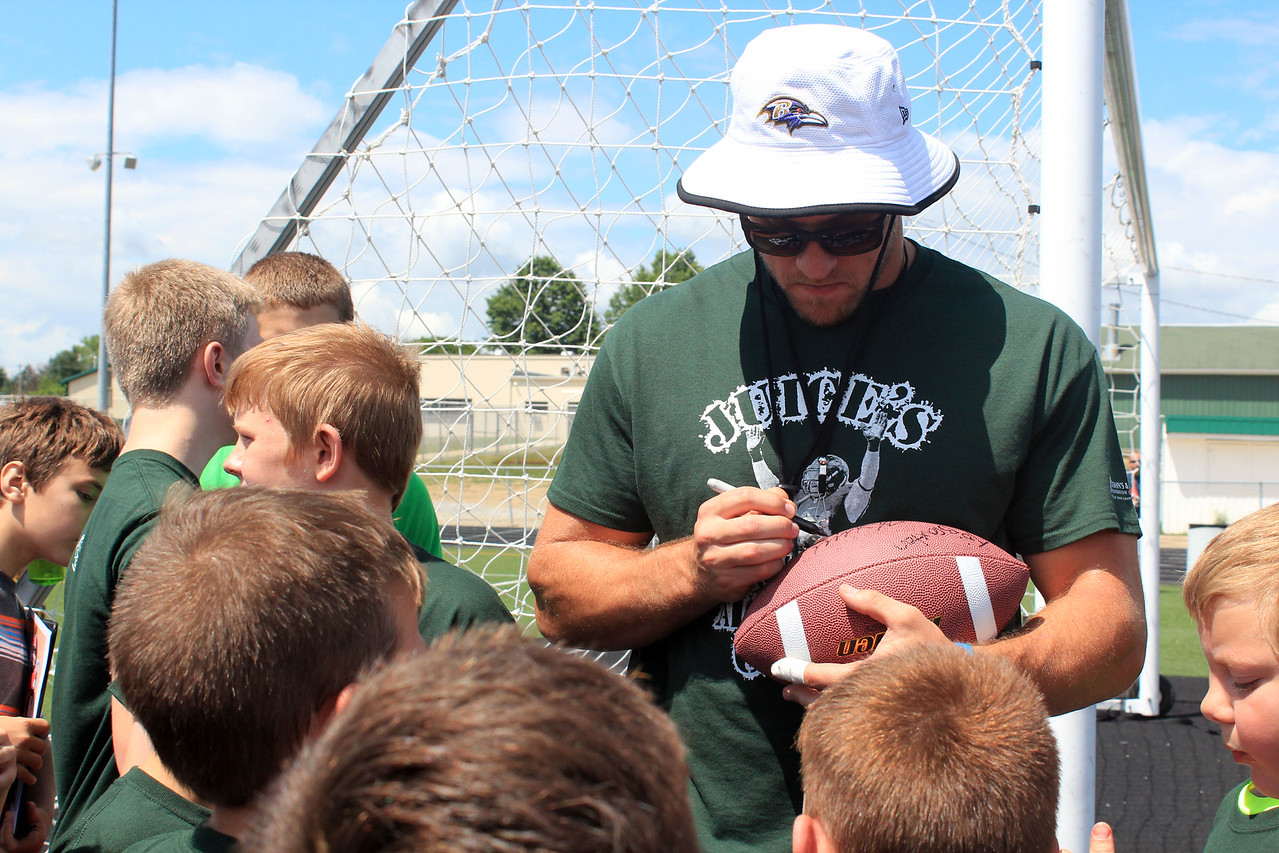 HALEE HEIRONIMUS / GAZETTE Kyle Juszczyk signed autographs on footballs, cleats, T-shirts and newspapers for campers.