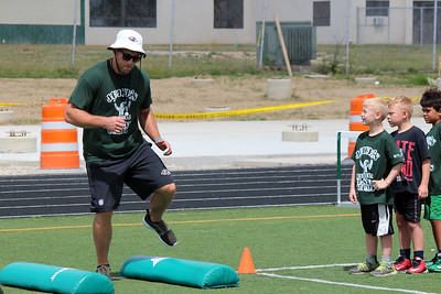 HALEE HEIRONIMUS / GAZETTE Kyle Juszczyk demonstrates a speed and footskills drill to the campers.