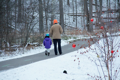 ALEC SMITH / GAZETTE Daniel Raible of Valley City in Liverpool Township walks with his 4-year-old daughter Lynette Raible during a Cleveland Metroparks program held Saturday called the Last Sunrise of the Year at Hinckley Reservation.