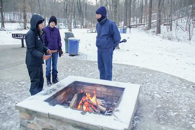 ALEC SMITH / GAZETTE Kathy Schmidt of Cleveland Metroparks (left) talks with Linda Gallam (center) and Glen Bowers, both of North Ridgeville, during a Saturday program called the Last Sunrise of the Year at Hinckley Lake. The walk was scheduled to celebrate the last day of 2016.