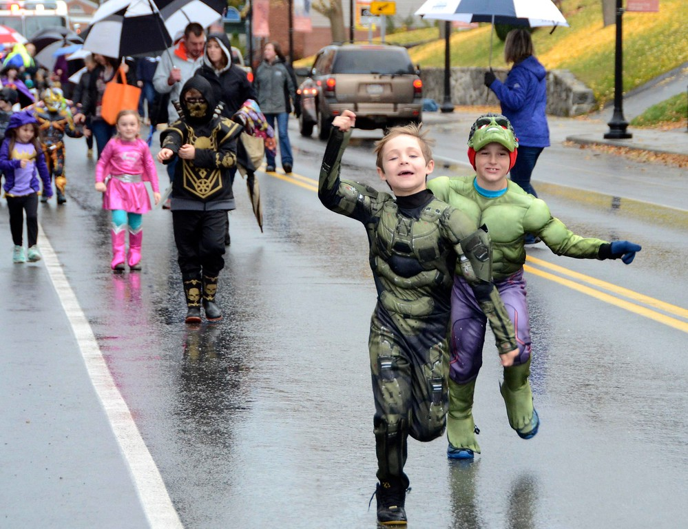 . Best friends Cameron Odvar and Jaydon Dimitropolis, both 8 years old, run together down Park Street in Adams during the Adams Lions Club\'s annual Halloween Parade. Sunday October 30, 2016. Gillian Jones � The Berkshire Eagle