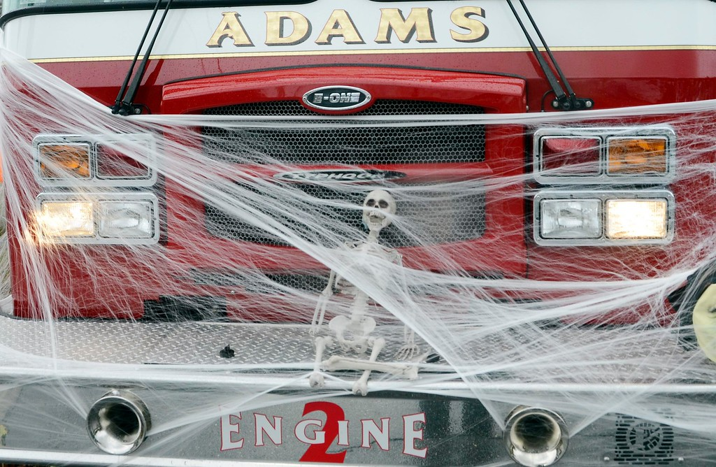 . Decorated in cobwebs, a skeleton and ghouls, the Adams Alert Hose\'s Firetruck Engine 2 drove in the Adams Lions Club\'s annual Halloween Parade. Sunday October 30, 2016. Gillian Jones � The Berkshire Eagle