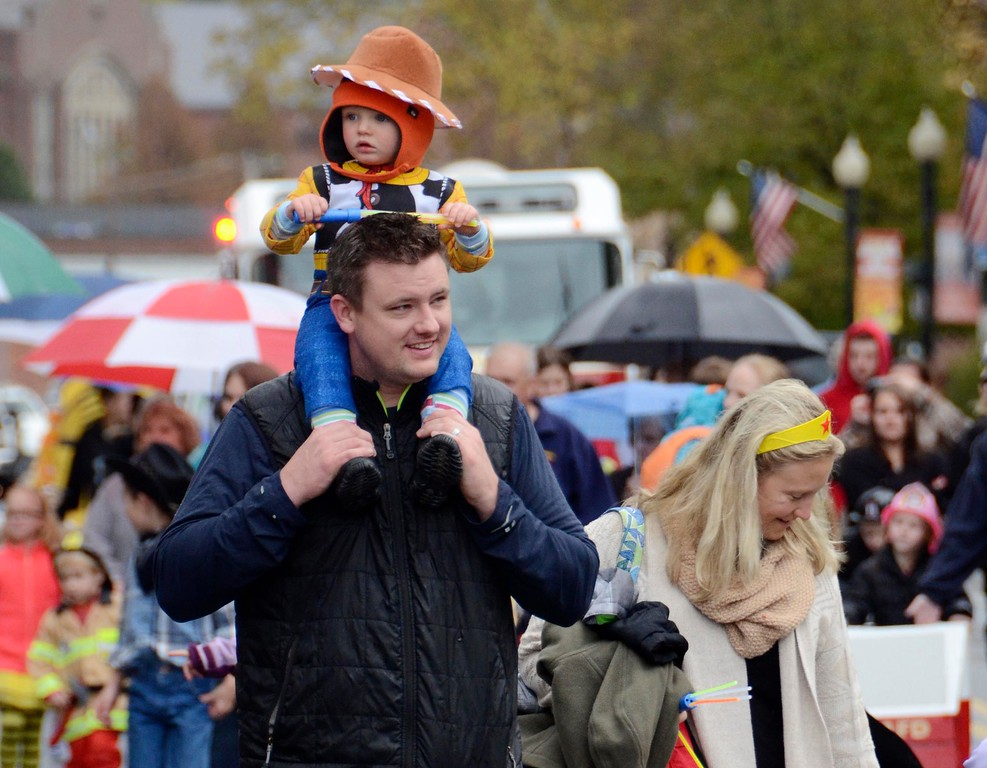. Dressed as Woody, of Toy Story, while his brother Mason dressed as Buzzlightyear, Caden Stump, 18 mos, sits on the shoulders of his dad Jason as he, his brother, and mom, Andrea, march along Park Street in Adams for the Adams Lions Club\'s annual Halloween Parade. Sunday October 30, 2016. Gillian Jones � The Berkshire Eagle