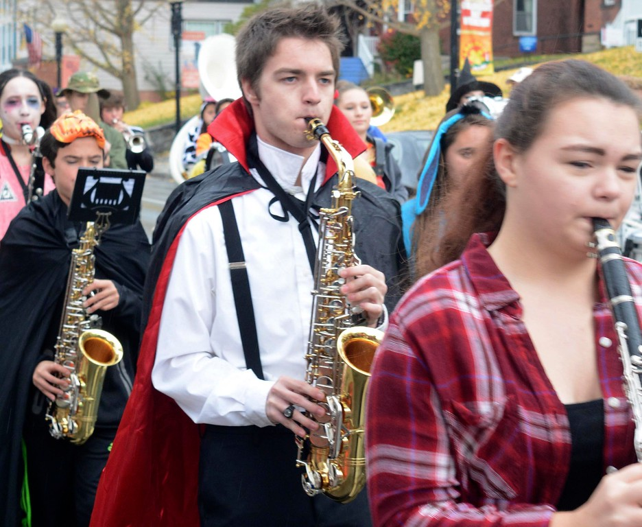 . Jake Meczywor, 17, plays the alto saxophone in the Adams Lions Club\'s annual Halloween Parade as he marches with members of the Hoosac Valley High School Marching Band. Sunday October 30, 2016. Gillian Jones � The Berkshire Eagle