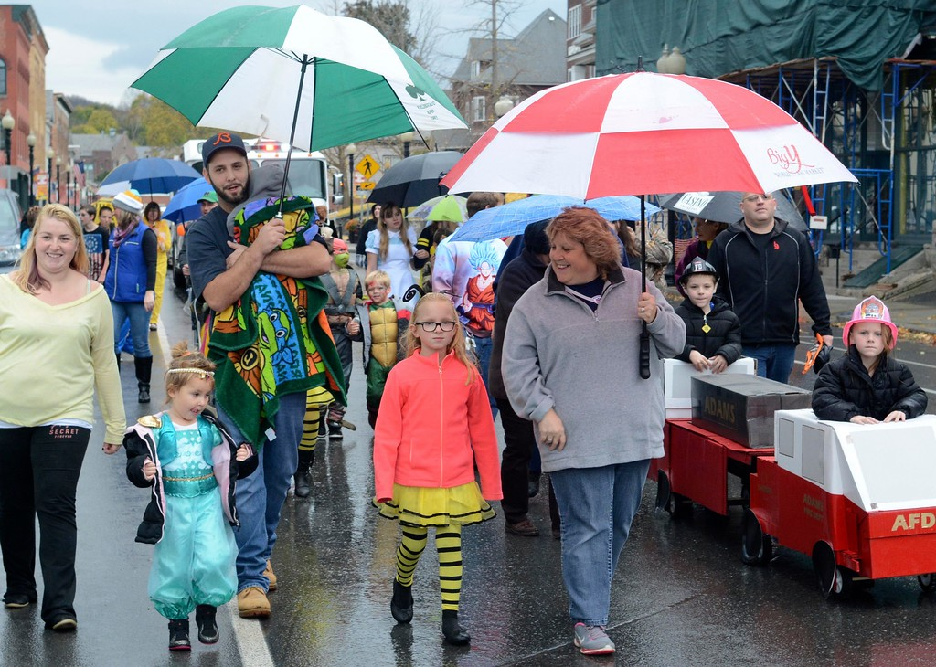 . Children and their parents march along Park Street in Adams for the Adams Lions Club\'s annual Halloween Parade. Sunday October 30, 2016. Gillian Jones � The Berkshire Eagle